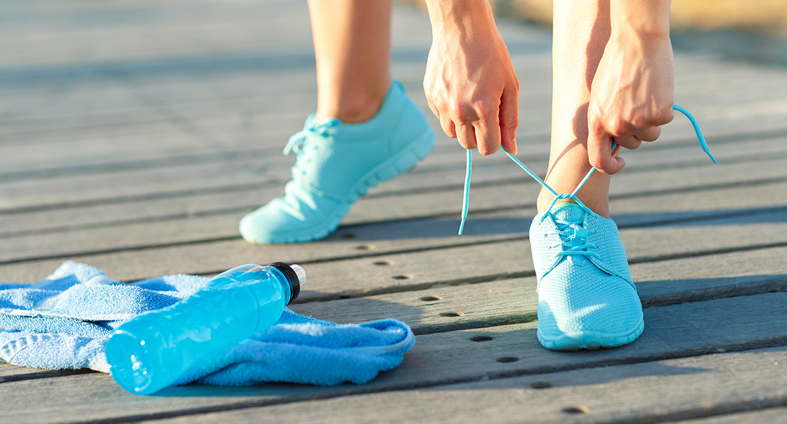Running shoes – woman tying shoe laces